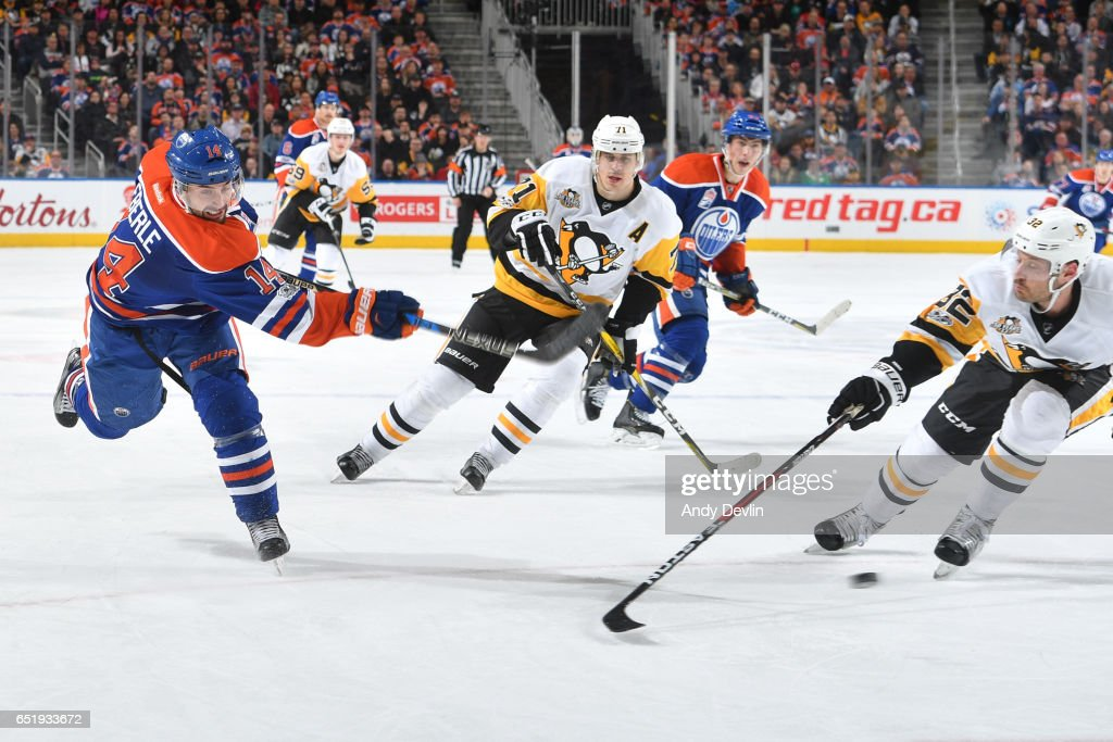 Jordan Eberle #14 of the Edmonton Oilers takes a shot during the game against the Pittsburgh Penguins on March 10, 2017 at Rogers Place in Edmonton, Alberta, Canada.