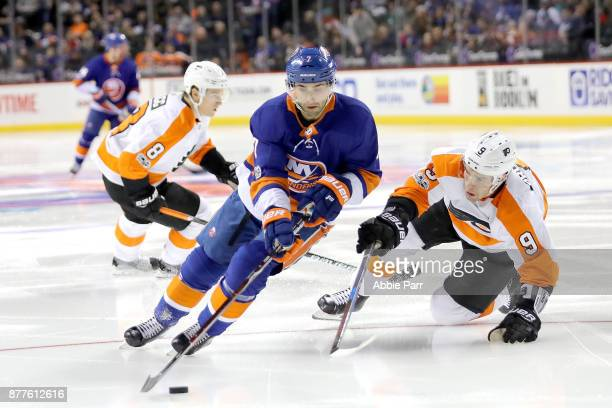 Jordan Eberle of the New York Islanders and Ivan Provorov of the Philadelphia Flyers chase after the puck in the second period during their game at...