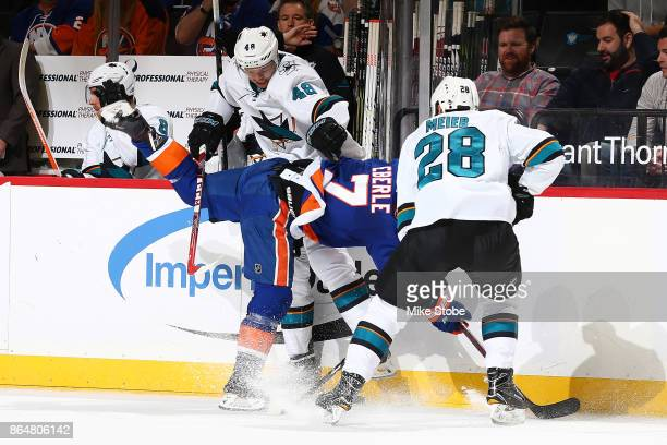 Jordan Eberle of the New York Islanders loses his footing during a battle with Timo Meier and Tomas Hertl of the San Jose Sharks at Barclays Center...