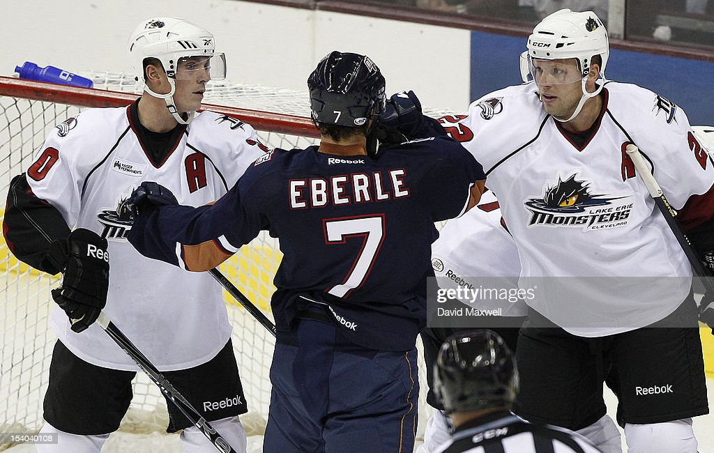 <a gi-track='captionPersonalityLinkClicked' href=/galleries/search?phrase=Jordan+Eberle&family=editorial&specificpeople=4898161 ng-click='$event.stopPropagation()'>Jordan Eberle</a> #7 of the Oklahoma City Barons is challenged by Bryan Lerg #20 and <a gi-track='captionPersonalityLinkClicked' href=/galleries/search?phrase=Thomas+Pock&family=editorial&specificpeople=220632 ng-click='$event.stopPropagation()'>Thomas Pock</a> #22 of the Lake Erie Monsters during their game on October 12, 2012 at Quicken Loans Arena in Cleveland, Ohio. The Monsters defeated the Barons 2-1.
