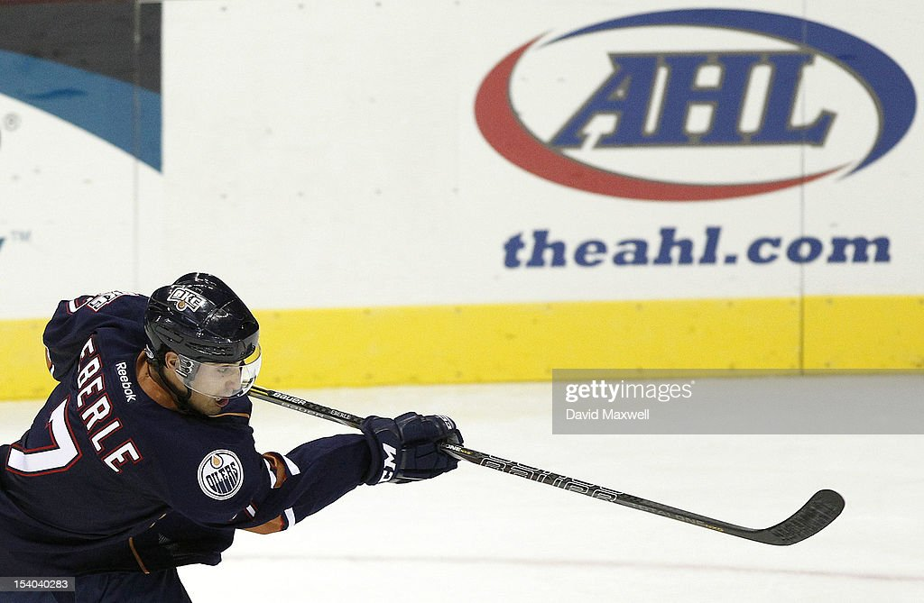 <a gi-track='captionPersonalityLinkClicked' href=/galleries/search?phrase=Jordan+Eberle&family=editorial&specificpeople=4898161 ng-click='$event.stopPropagation()'>Jordan Eberle</a> #7 of the Oklahoma City Barons takes a shot against the Lake Erie Monsters during their game on October 12, 2012 at Quicken Loans Arena in Cleveland, Ohio. The Monsters defeated the Barons 2-1.