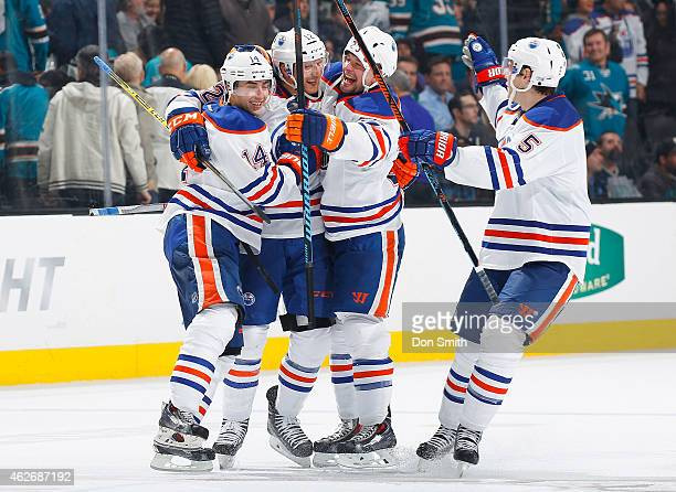 Jordan Eberle Rob Klinkhammer Matt Hendricks and Mark Fayne of the Edmonton Oilers celebrate after Klinkhammer's shootout goal in the 13 round to win...
