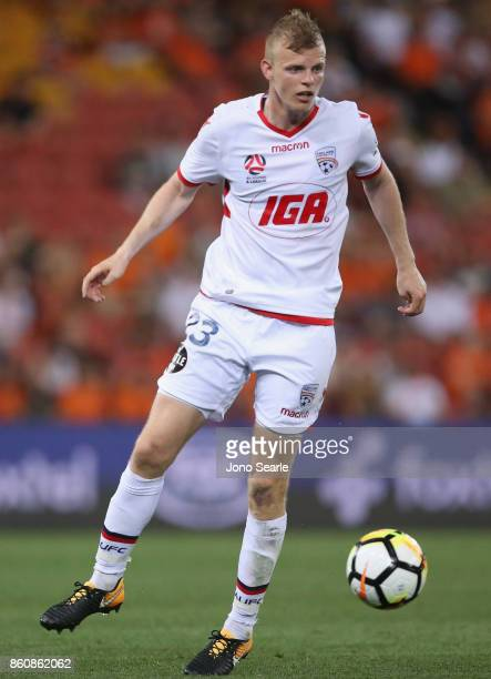 Jordan Elsey of Adelaide runs with the ball during the round two ALeague match between the Brisbane Roar and Adelaide United at Suncorp Stadium on...
