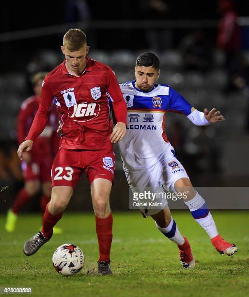 Jordan Elsey of United and Dimitri Petratos compete for the ball during the round of 32 FFA Cup match between Adelaide United and the Newcastle Jets...