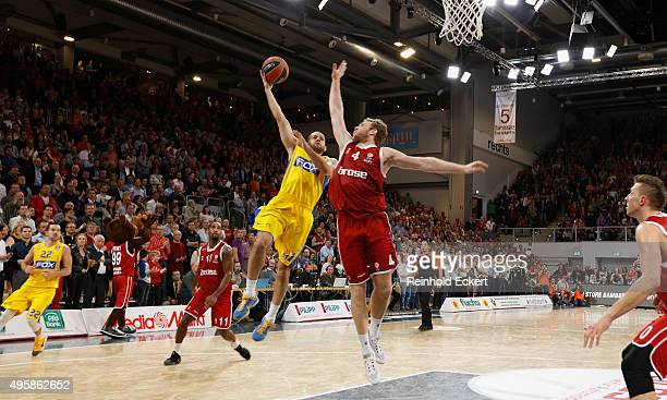 Jordan Farmar #1 of Maccabi Fox Tel Aviv competes with Nicolo Melli #4 of Brose Baskets Bamberg during the Turkish Airlines Euroleague Basketball...