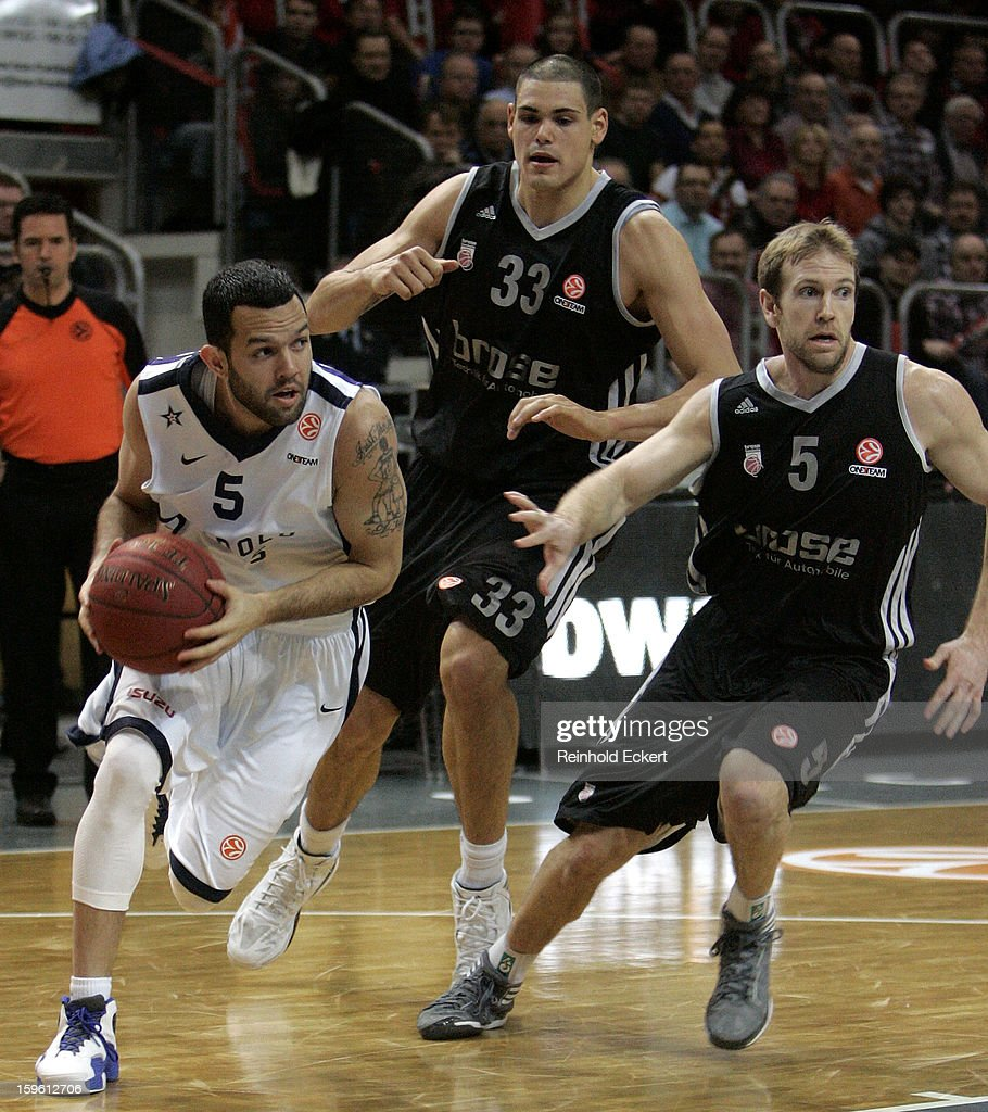 Jordan Farmar, #5 of Anadolu Efes Istanbul competes with John Goldsberry, #5 and Maik Zirbes, #33 of Brose Baskets Bamberg during the 2012-2013 Turkish Airlines Euroleague Top 16 Date 4 between Brose Baskets Bamberg v Anadolu EFES Istanbul at Stechert Arena on January 17, 2013 in Bamberg, Germany.