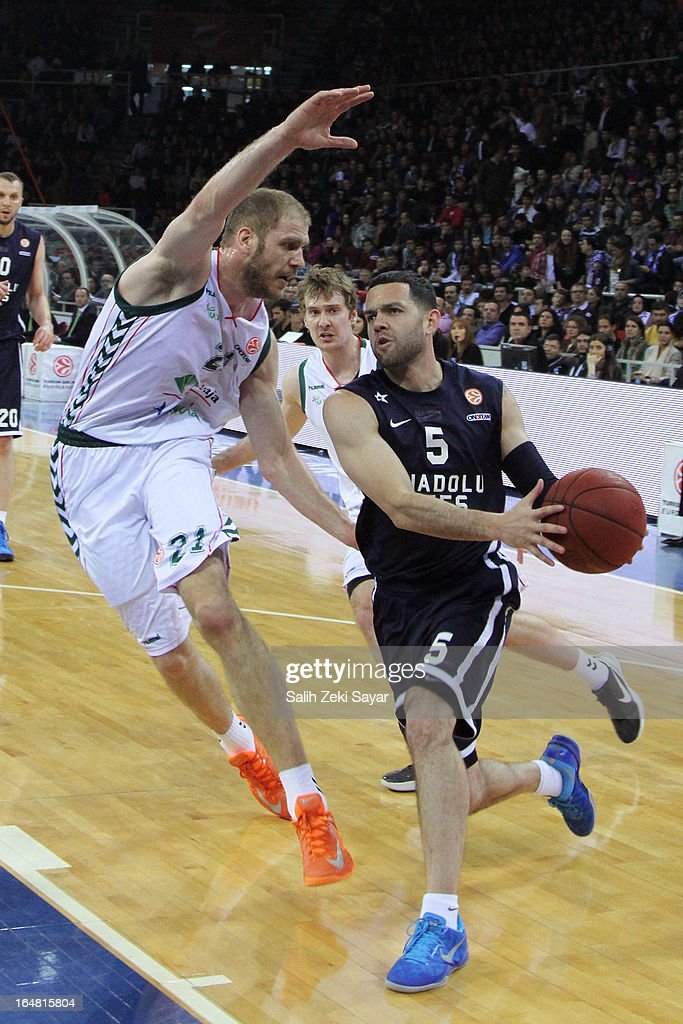 Jordan Farmar #5 of Anadolu Efes competes with Luka Zoric #21 of Unicaja Malaga during the 2012-2013 Turkish Airlines Euroleague Top 16 Date 13 between Anadolu EFES Istanbul v Unicaja Malaga at Abdi Ipekci Sports Arena on March 28, 2013 in Istanbul, Turkey.