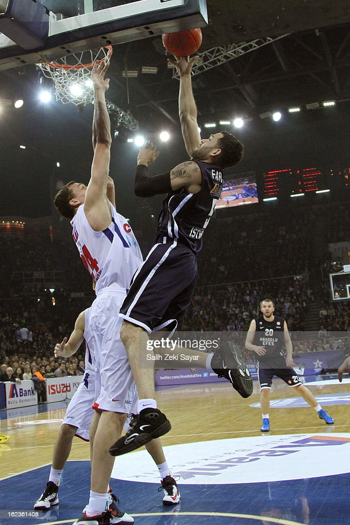 Jordan Farmar #5 of Anadolu Efes competes with Sasha Kaun #24 of CSKA Moscow during the 2012-2013 Turkish Airlines Euroleague Top 16 Date 8 between Anadolu EFES Istanbul v CSKA Moscow at Abdi Ipekci Sports Arena on February 22, 2013 in Istanbul, Turkey.