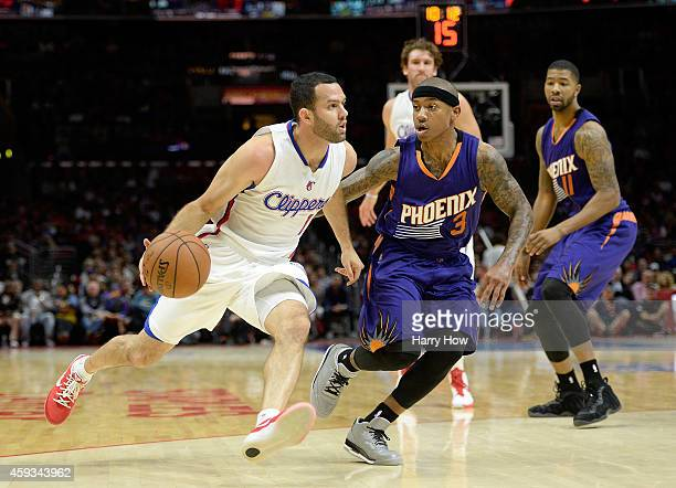 Jordan Farmar of the Los Angeles Clippers dribbles from Isaiah Thomas of the Phoenix Suns at Staples Center on November 15 2014 in Los Angeles...
