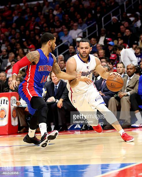 Jordan Farmar of the Los Angeles Clippers drives against DJ Augistin of the Detroit Pistons at Staples Center on December 15 2014 in Los Angeles...