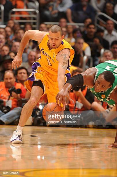Jordan Farmar of the Los Angeles Lakers chases after a loose ball against Glen Davis of the Boston Celtics in Game Six of the 2010 NBA Finals on June...