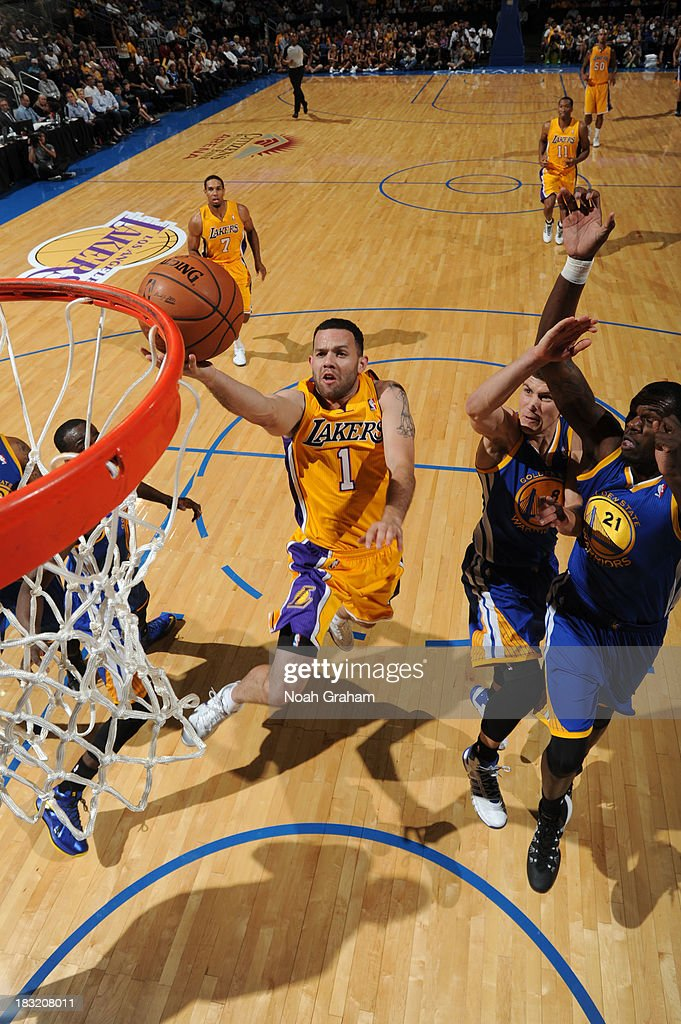 <a gi-track='captionPersonalityLinkClicked' href=/galleries/search?phrase=Jordan+Farmar&family=editorial&specificpeople=228137 ng-click='$event.stopPropagation()'>Jordan Farmar</a> #1 of the Los Angeles Lakers drives to the basket against the Golden State Warriors at Citizens Business Bank Arena on October 5, 2013 in Ontario, California.