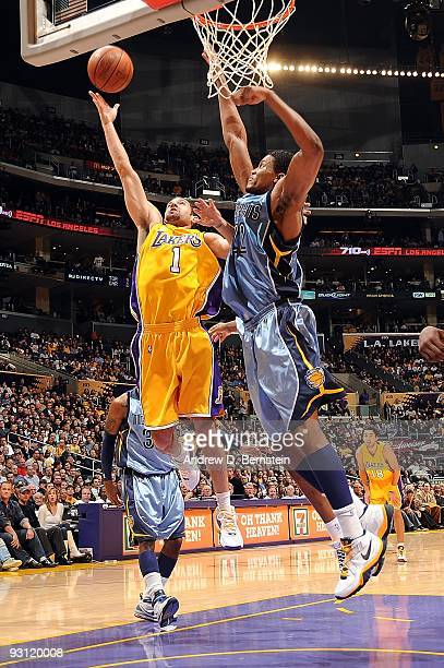 Jordan Farmar of the Los Angeles Lakers goes to the basket under pressure against Rudy Gay of the Memphis Grizzlies during the game on November 6...
