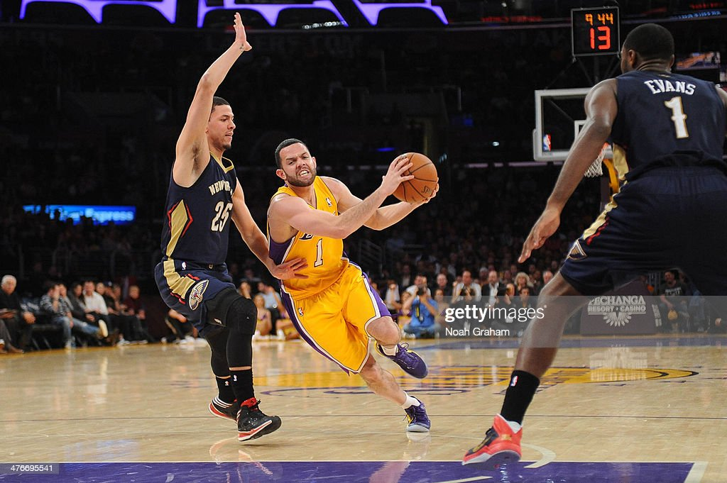 Jordan Farmar #1 of the Los Angeles Lakers goes to the hoop against Austin Rivers #25 of the New Orleans Pelicans at Staples Center on March 4, 2014 in Los Angeles, California.