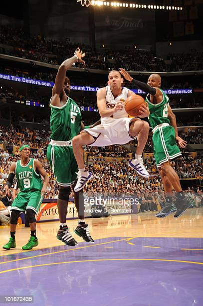 Jordan Farmar of the Los Angeles Lakers goes up for a shot between Kevin Garnett and Ray Allen of the Boston Celtics in Game Two of the 2010 NBA...