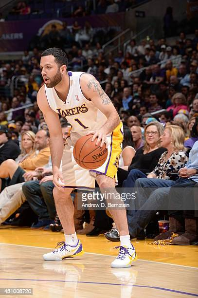 Jordan Farmar of the Los Angeles Lakers handles the ball against the Memphis Grizzlies at Staples Center on April 13 2014 in Los Angeles California...