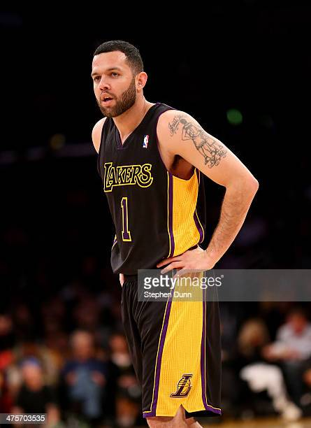 Jordan Farmar of the Los Angeles Lakers looks on during the game with the Sacramento Kings at Staples Center on February 28 2014 in Los Angeles...
