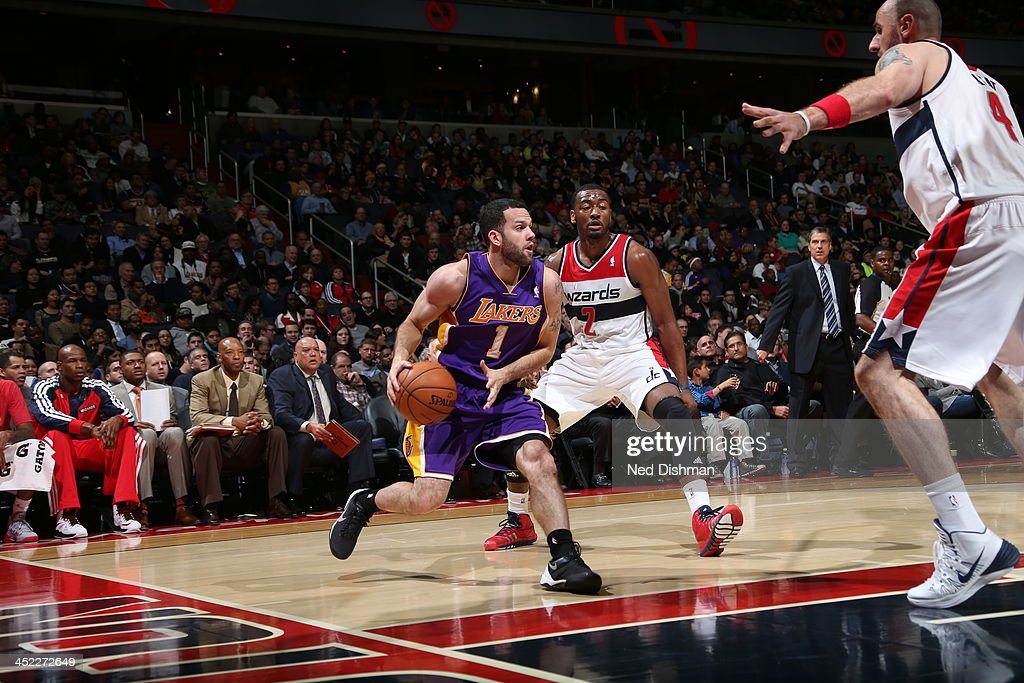 <a gi-track='captionPersonalityLinkClicked' href=/galleries/search?phrase=Jordan+Farmar&family=editorial&specificpeople=228137 ng-click='$event.stopPropagation()'>Jordan Farmar</a> #1 of the Los Angeles Lakers looks to pass for the open shot against the Washington Wizards during the game at the Verizon Center on November 26, 2013 in Washington, DC.