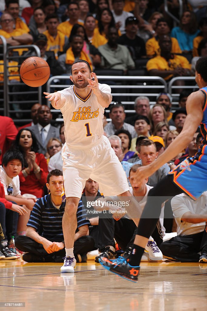 <a gi-track='captionPersonalityLinkClicked' href=/galleries/search?phrase=Jordan+Farmar&family=editorial&specificpeople=228137 ng-click='$event.stopPropagation()'>Jordan Farmar</a> #1 of the Los Angeles Lakers passes the ball against the Oklahoma City Thunder at STAPLES Center on March 9, 2014 in Los Angeles, California.