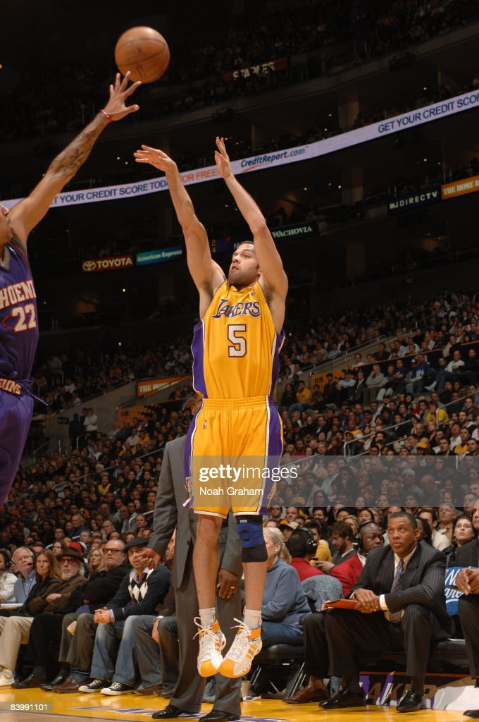 Jordan Farmar #5 of the Los Angeles Lakers shoots against Matt Barnes #22 of the Phoenix Suns at Staples Center on December 10, 2008 in Los Angeles, California.