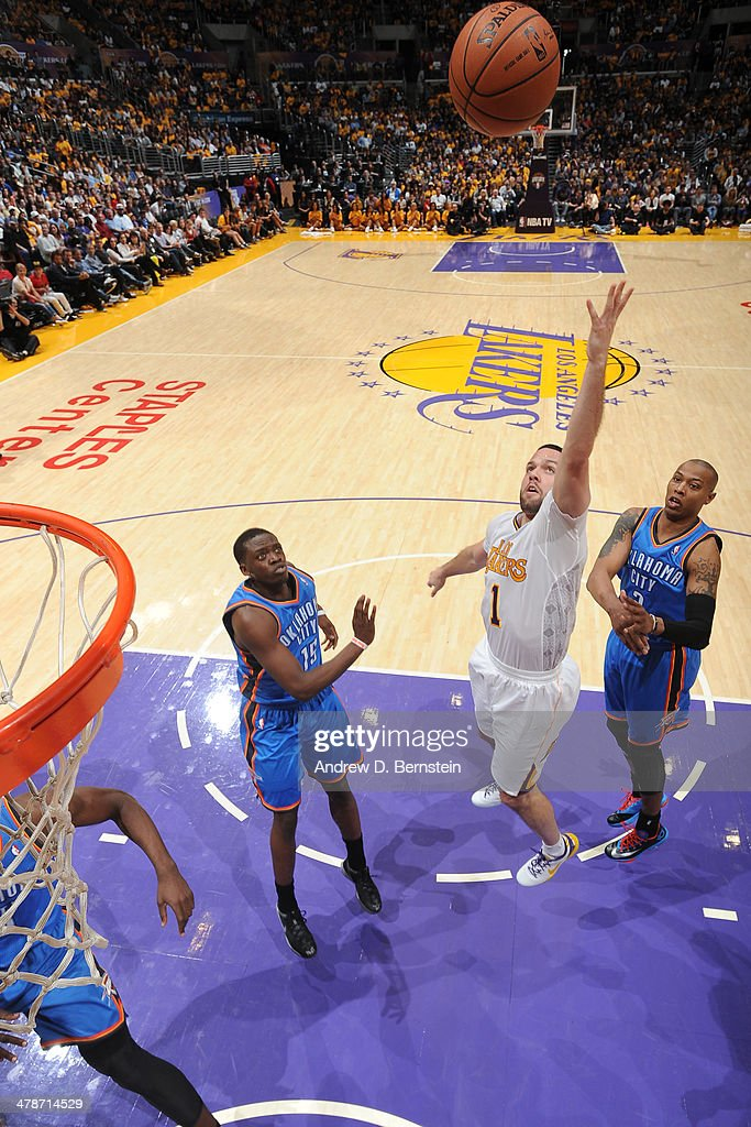 <a gi-track='captionPersonalityLinkClicked' href=/galleries/search?phrase=Jordan+Farmar&family=editorial&specificpeople=228137 ng-click='$event.stopPropagation()'>Jordan Farmar</a> #1 of the Los Angeles Lakers shoots against the Oklahoma City Thunder at STAPLES Center on March 9, 2014 in Los Angeles, California.