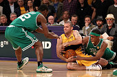 Jordan Farmar of the Los Angeles Lakers tries to hold on to the ball under pressure from Tony Allen and Rajon Rondo of the Boston Celtics in Game Six...