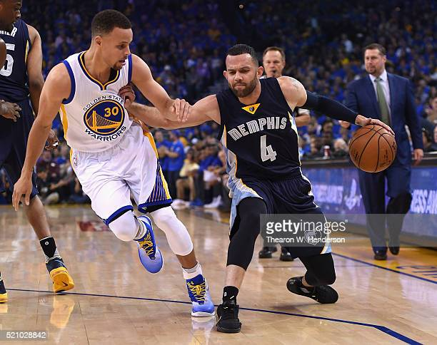 Jordan Farmar of the Memphis Grizzlies handles the ball against Stephen Curry of the Golden State Warriors in the first half during the game at...