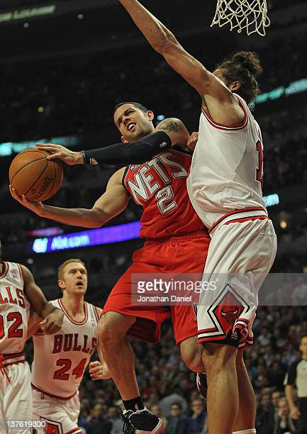 Jordan Farmar of the New Jersey Nets puts up a shot against Joakim Noah of the Chicago Bulls at the United Center on January 23 2012 in Chicago...
