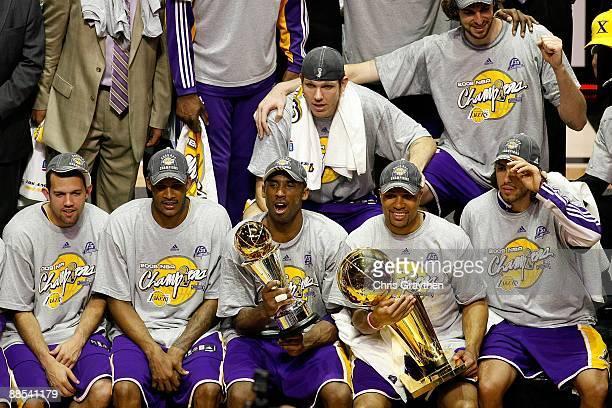 Jordan Farmar Trevor Ariza Kobe Bryant Luke Walton Derek Fisher Pau Gasol and Sasha Vujacic of the Los Angeles Lakers pose together after defeating...