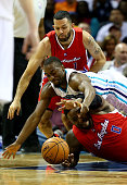 Jordan Farmar watches as his teamamte Glen Davis of the Los Angeles Clippers goes after a loose ball against Kemba Walker of the Charlotte Hornets...