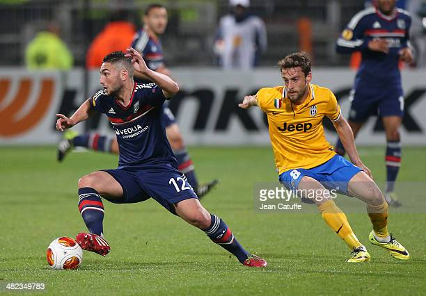 Jordan Ferri of Lyon and Claudio Marchisio of Juventus in action during the UEFA Europa League quarter final match between Olympique Lyonnais OL and...