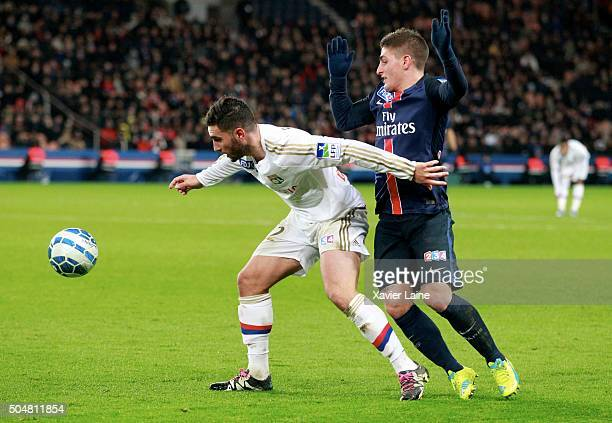 Jordan Ferri of Olympic Lyonnais in action with Marco Verratti of Paris SaintGermain during the French Ligue Cup between Paris SaintGermain and...