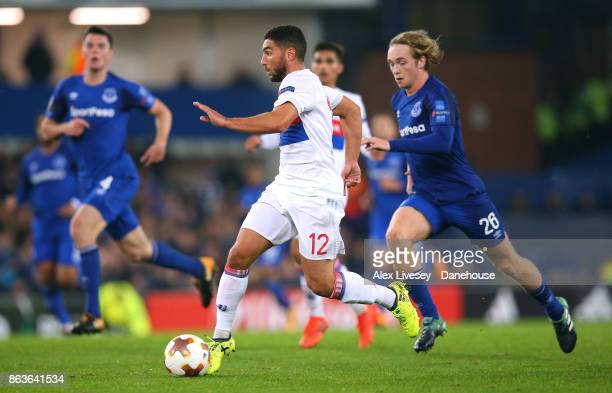 Jordan Ferri of Olympique Lyon beats Tom Davies of Everton FC during the UEFA Europa League group E match between Everton FC and Olympique Lyon at...