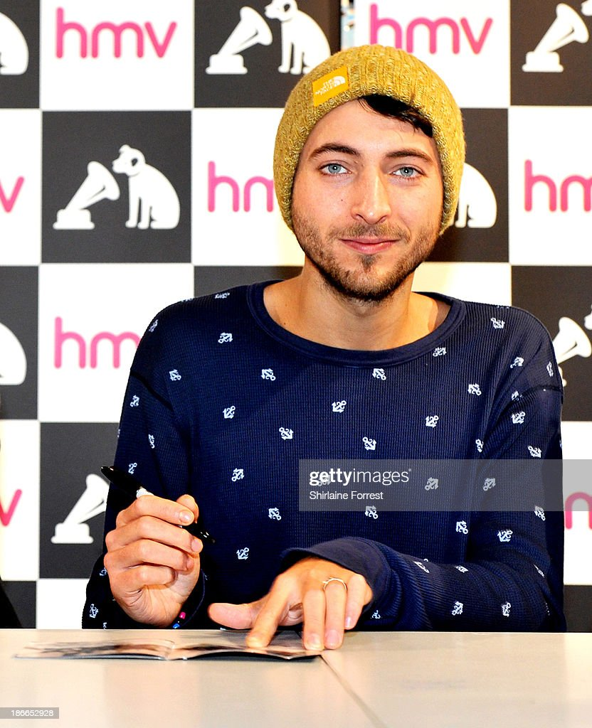 Jordan Fish of Bring Me The Horizon meets fans and signs copies of a new HMV Exclusive T-Shirt at HMV Birmingham Bullring on November 2, 2013 in Birmingham, England.