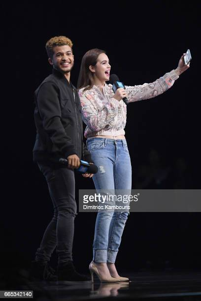 Jordan Fisher and Bailee Madison speak on stage during WE Day New York Welcome to celebrate young people changing the world at Radio City Music Hall...