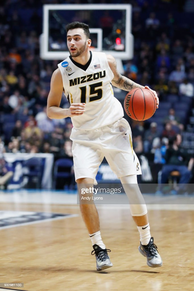 Jordan Geist #15 of the Missouri Tigers dribbles with the ball against the Florida State Seminoles during the game in the first round of the 2018 NCAA Men's Basketball Tournament at Bridgestone Arena on March 16, 2018 in Nashville, Tennessee.