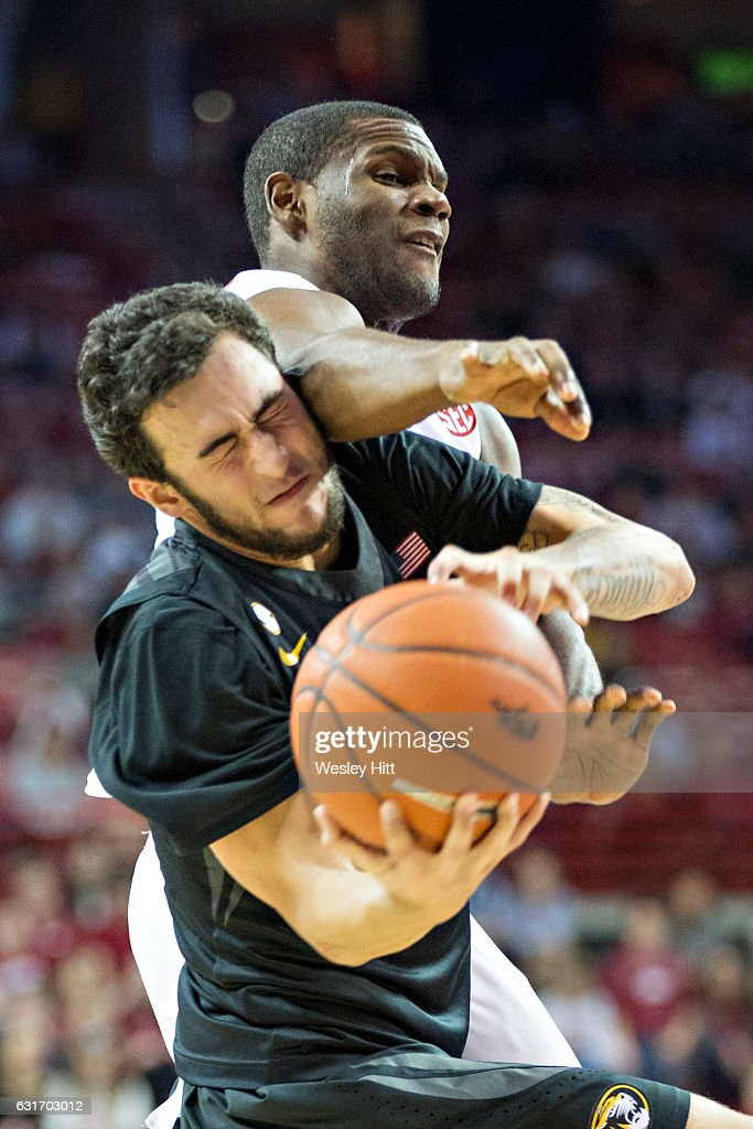Jordan Geist #15 of the Missouri Tigers tries to drive around and is fouled by Trey Thompson #1 of the Arkansas Razorbacks at Bud Walton Arena on January 14, 2017 in Fayetteville, Arkansas. The Razorbacks defeated the Tigers 92-73.