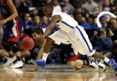 Jordan Giusti of the St Mary's Gaels fights for control of a looseball with Joe Jackson of the Memphis Tigers during the second round of the 2013...