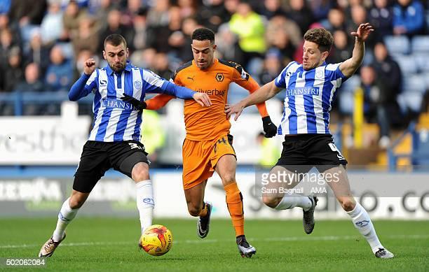 Jordan Graham of Wolverhampton Wanderers with Jack Hunt of Sheffield Wednesday and Sam Hutchinson of Sheffield Wednesday during the Sky Bet...