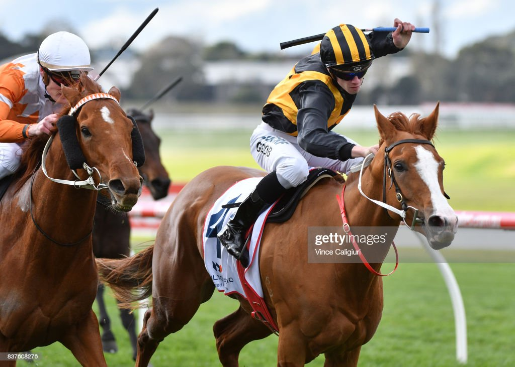 Jordan Grob riding Special Diva (r) defeats Mark Zahra riding Gold Fontein in Race 4 during Melbourne Racing at Sandown Hillside on August 23, 2017 in Melbourne, Australia.