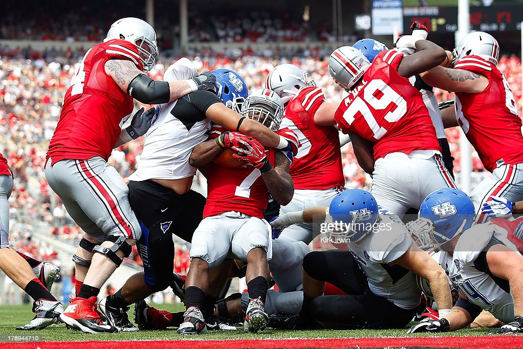 Jordan Hall #7 of the Ohio State Buckeyes is wrapped up at the line of scrimmage by Beau Bachtelle #95 of the Buffalo Bulls during the fourth quarter on August 31, 2013 at Ohio Stadium in Columbus, Ohio. Ohio State defeated Buffalo 40-20.