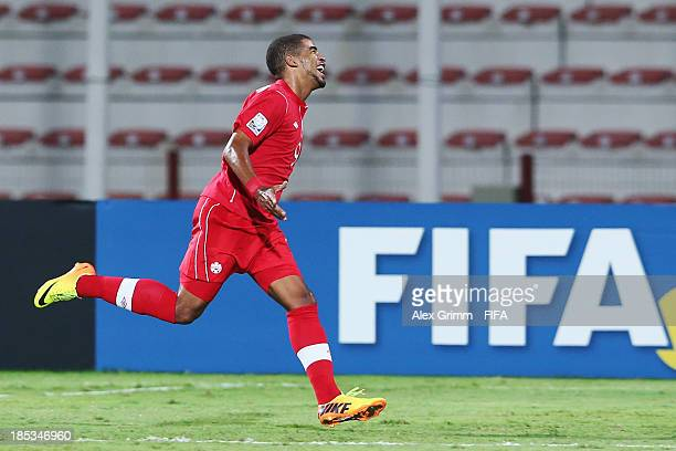 Jordan Hamilton of Canada celebrates his team's first goal during the FIFA U17 World Cup UAE 2013 Group E match between Canada and Austria at Al...
