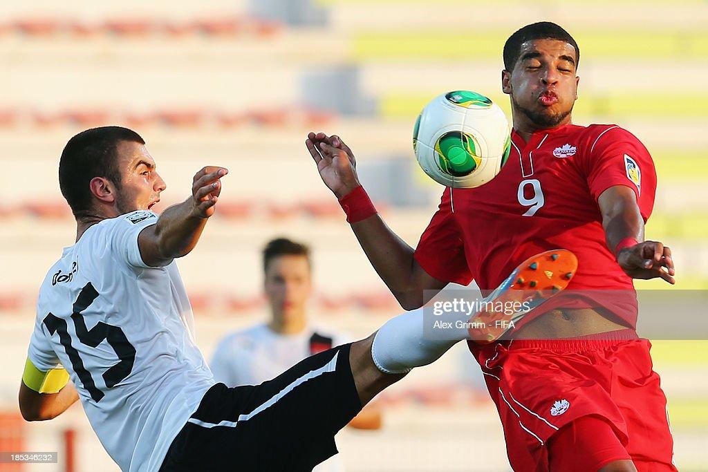 Jordan Hamilton (R) of Canada is challenged by David Domej of Austria during the FIFA U-17 World Cup UAE 2013 Group E match between Canada and Austria at Al Rashid Stadium on October 19, 2013 in Dubai, United Arab Emirates.