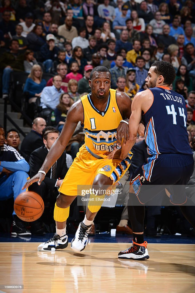 Jordan Hamilton #1 of the Denver Nuggets drives against Jeffery Taylor #44 of the Charlotte Bobcats on December 22, 2012 at the Pepsi Center in Denver, Colorado.