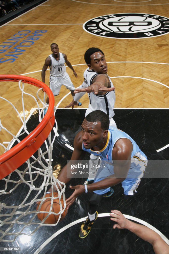 Jordan Hamilton #1 of the Denver Nuggets drives to the basket against <a gi-track='captionPersonalityLinkClicked' href=/galleries/search?phrase=MarShon+Brooks&family=editorial&specificpeople=4884862 ng-click='$event.stopPropagation()'>MarShon Brooks</a> #9 of the Brooklyn Nets on February 13, 2013 at the Barclays Center in the Brooklyn borough of New York City in New York City.