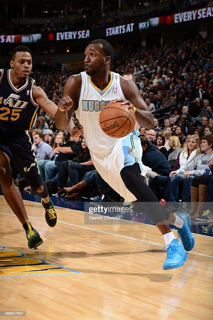 Jordan Hamilton #1 of the Denver Nuggets drives to the basket against the Utah Jazz on December 13, 2013 at the Pepsi Center in Denver, Colorado.