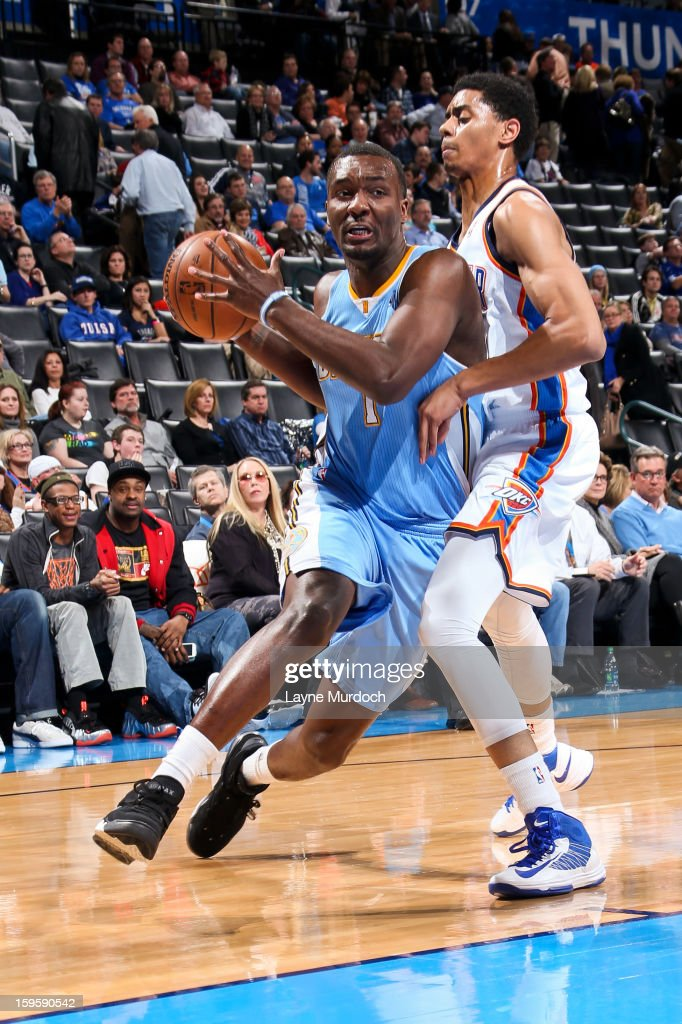 Jordan Hamilton #1 of the Denver Nuggets droves against <a gi-track='captionPersonalityLinkClicked' href=/galleries/search?phrase=Jeremy+Lamb&family=editorial&specificpeople=7407506 ng-click='$event.stopPropagation()'>Jeremy Lamb</a> #11 of the Oklahoma City Thunder on January 16, 2013 at the Chesapeake Energy Arena in Oklahoma City, Oklahoma.