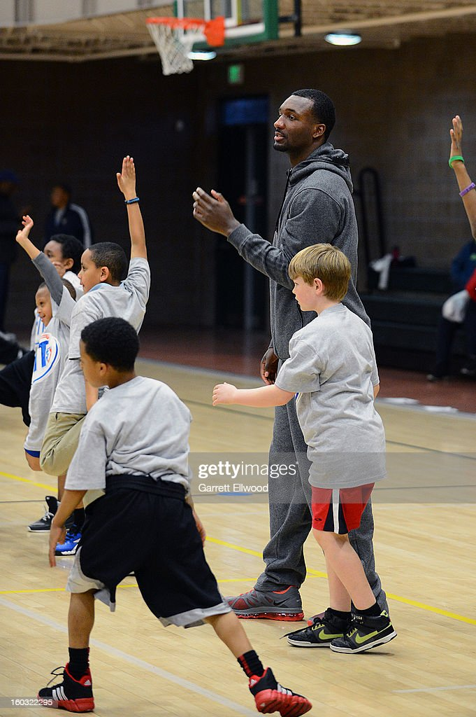 Jordan Hamilton #1 of the Denver Nuggets encourages children during a Team Fit Clinic on January 25, 2013 at the Hiawatha Davis Recreation Center in Denver, Colorado.