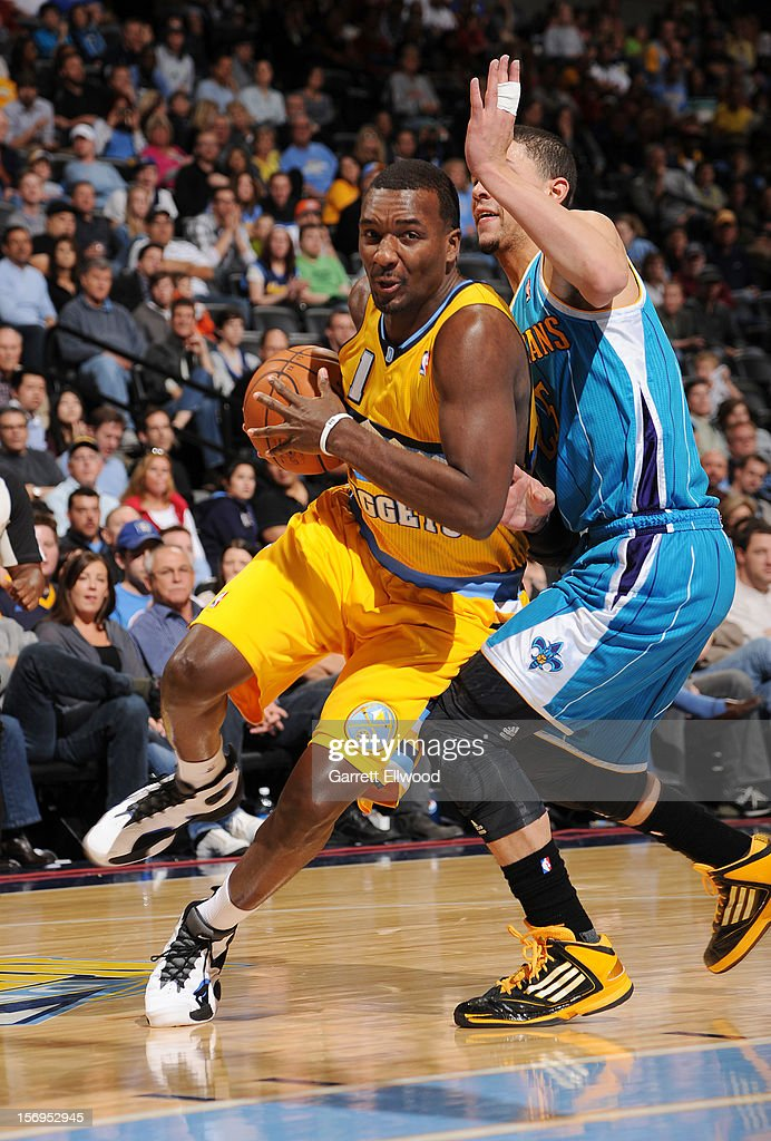 Jordan Hamilton #1 of the Denver Nuggets protecs the ball from <a gi-track='captionPersonalityLinkClicked' href=/galleries/search?phrase=Austin+Rivers&family=editorial&specificpeople=7117574 ng-click='$event.stopPropagation()'>Austin Rivers</a> #25 of the New Orleans Hornets during the game between the New Orleans Hornets and the Denver Nuggets on November 25, 2012 at the Pepsi Center in Denver, Colorado.