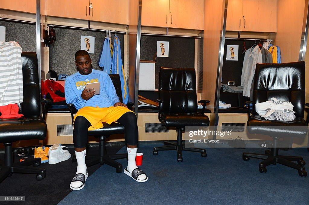 Jordan Hamilton #1 of the Denver Nuggets reads before the game against the New York Knicks on March 13, 2013 at the Pepsi Center in Denver, Colorado.